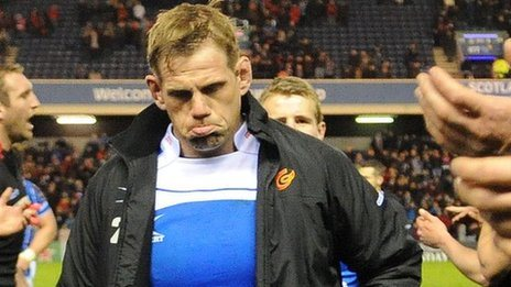 Rhys Thomas is dejected as he leaves the pitch at Murrayfield