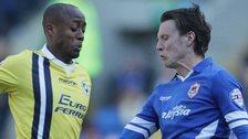 Joe Mason of Cardiff City is tackled by Nadjim Abdou of Millwall