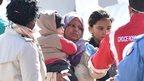 Migrants arrive in the Sicilian port of Messina, 18 April
