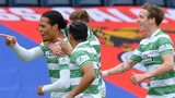 Virgil van Dijk celebrates scoring for Celtic