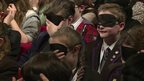 School Reporters wearing blindfolds