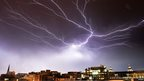 Large streaks of lightning over the Washington DC skyline