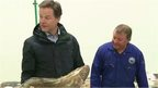 Nick Clegg with another man and a large fish