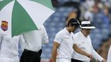 Alastair Cook walks of the field with umpire Steve Davis
