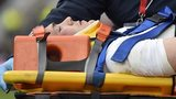 Mike Brown stretchered off the pitch during England's Six Nations match with Italy