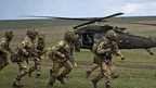 British soldiers take up positions in a military exercise