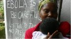 Woman in Sierra Leone with baby