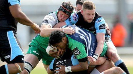 Connacht's Bundee Aki and Eoin McKeon battle with Glasgow's Finn Russell