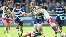 Sale's Mark Cueto is tacked by Harlequins winger Marland Yarde at the AJ Bell Stadium