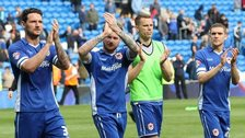 Cardiff City players applaud the fans after their last home match of 2014-15