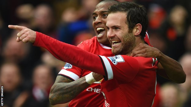 Ashley Young and Juan Mata celebrate during Manchester United's win over Manchester City