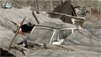 A car buried in the midst of ash and wreckage