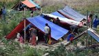 Nepalese people stay outside in tents on the outskirts of Kathmandu (26 April 2015)
