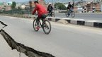 Damaged roads are seen after an earthquake on the outskirts of Kathmandu on April 26, 2015.