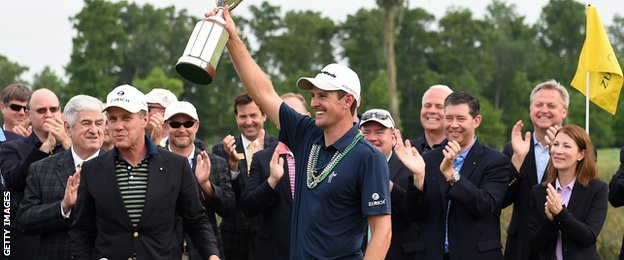 Justin Rose celebrates winning the Zurich Classic of New Orleans