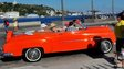 Tourists from the United States are seen in old American cars in Havana on 6 April, 2015.