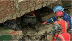 Rescuers search the rubble