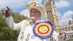 Leader of the Official Monster Raving Loony Party (OMRLP), Howling Laud Hope, poses for photographers