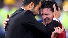 Pep Guradiola and Lionel Messi