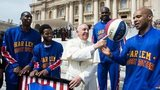 Harlem Globetrotters' Hi-Lite Bruton, left, Ant Atitkson, second from left, Big Easy Lofton, second from right, look at teammate Flight Time Lang, right, helping Pope Francis spin the ball on his finger as they meet during the general audience in St. Peter's Square at the Vatican, Wednesday, 6 May 6, 2015.