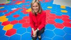 Sophie Raworth poses outside NBH with the UK map