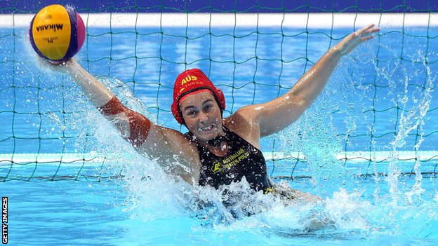Woman waterpolo player saving a goal