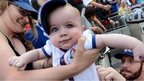 Texas Rangers' Josh Hamilton signs the back of a baby