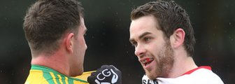 Patrick McBrearty of Donegal clashes with Tyrone's Ronan McNamee