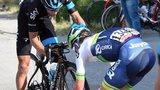 Simon Clarke fits a wheel to Richie Porte's bike
