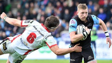 Finn Russell of Glasgow Warriors attacks Ulster
