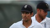Alastair Cook looks on