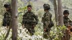 Colombian Army soldiers guard the area where an alleged FARC guerrilla attack on 14 April left 11 people dead, in Timba, Colombia, 15 April 2015.