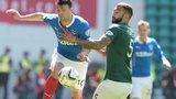 Hibernian defender Liam Fontaine (right) challenges Haris Vuckic