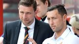 Ian Baraclough looks on with rested striker Scott McDonald