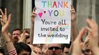 "A poster which states that ""everyone is invited to the wedding"""