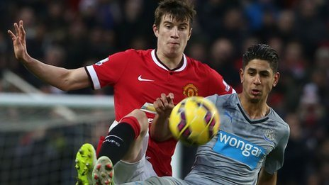 Paddy McNair challenges Newcastle United's Ayoze Perez