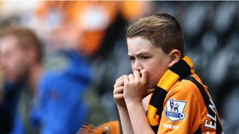 A young Hull City watches