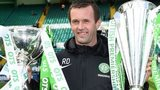 Celtic manager Ronny Deila holds the Scottish Premiership and Scottish League Cup trophies