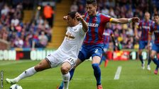 Swansea's Jefferson Montero is challenged by Joel Ward of Crystal Palace.