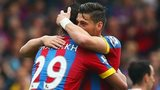 Marouane Chamakh celebrates with Joel Ward