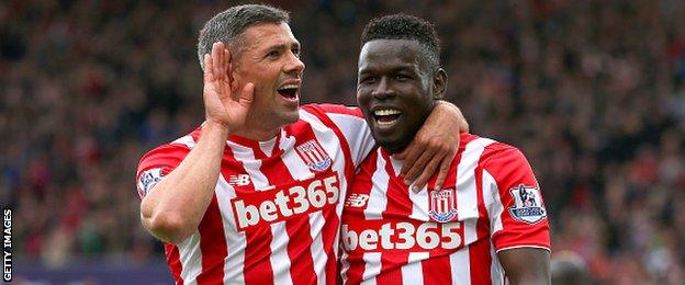 Stoke's Jonathan Walters (left) celebrates scoring against Liverpool