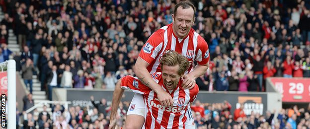 Stoke's ex-Liverpool striker Peter Crouch celebrates scoring his side's sixth goal former Reds midfielder Charlie Adam
