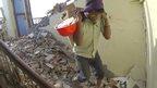 Man helping take apart building