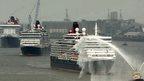 The ocean liners Queen Mary Two, Queen Victoria and Queen Elizabeth meet on the River Mersey