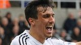 Jack Cork (L) celebrates scoring for Swansea City