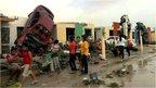 Inhabitants observe damages to houses