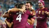 Queensland players celebate Origin victory