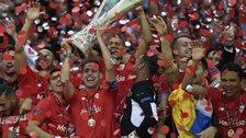 Sevilla lift the Europa League trophy