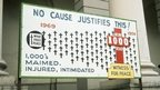 Billboard marking 1000th victim of NI Troubles, 1974