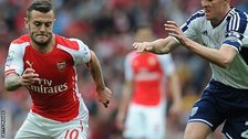 Arsenal's Jack Wilshere (left) in action against West Brom